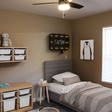 A childs bedroom with a small bed and shelves.